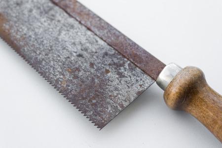 splitting up: old saw detail, vintage macro tool Stock Photo