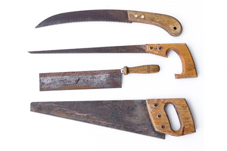 splitting up: vintage tools - set old saws, handsaws isolated Stock Photo