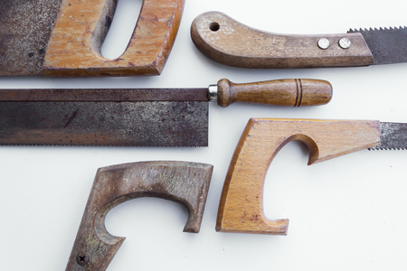 splitting up: saw old handsaw isolated - vintage Tools Stock Photo