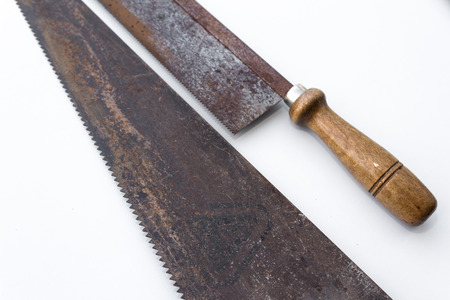 splitting up: SAW Handsaws detail - Vintage tools on white Stock Photo