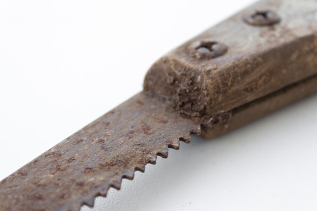 splitting up: saw old handsaw isolated - vintage tools tool dirty gardening