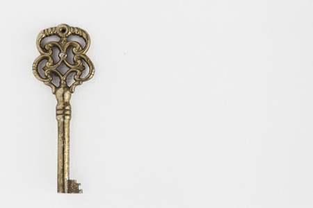 old ornate key on white background with copy space Stock Photo