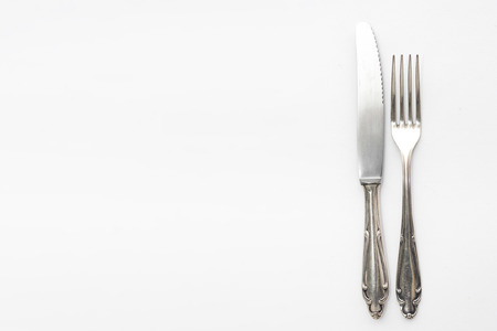 silver cutlery: silver cutlery, fork and knife isolated on white background Stock Photo