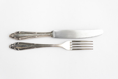 silver cutlery: silver cutlery, fork and knife on white background