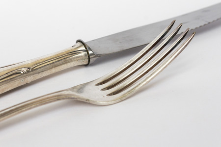 silver flatware: knife and fork closeup - sterling cutlery, old silver flatware set