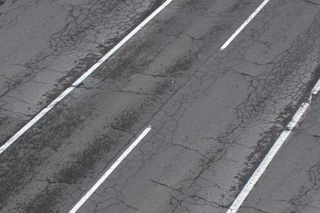old broken  road with cracked asphalt, damaged highway
