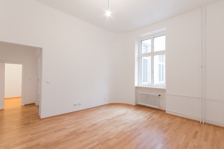renovation property: fresh renovated flat - home apartment - fresh renovated room with wooden oak floor, Whitewalls and window Stock Photo