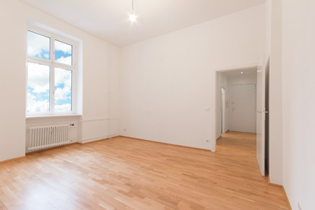 renovated flat - empty room, white walls wooden floor