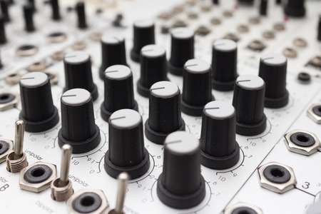 knobs: Knobs on analog synthesizers - Music Equipment closeup Stock Photo