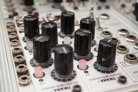 Knobs on analog synthesizers - Music Equipment closeup Фото со стока