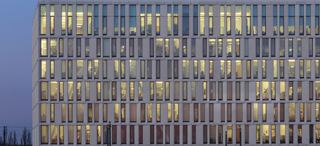 modern office building facade - Business people working Stock Photo