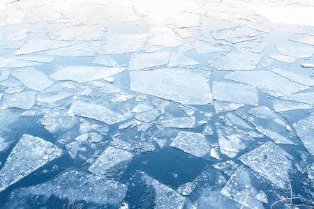 ice floes: iced river, floating ice floes on water - winter background