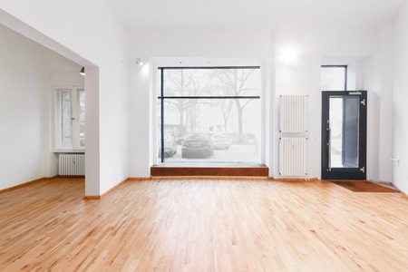 renovated: renovated room with shopping window - empty store  shop with wooden floor and white walls Stock Photo