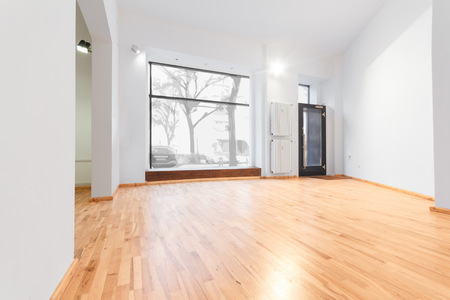 renovated room with shopping window - empty store shop with wooden floor and Whitewalls