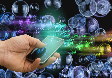 colorful light display: holding mobile phone, smart phone concept - colorful light effects over display Stock Photo