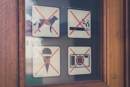 No signs  no dogs, no smoking, no photo, no ice cream signs on door