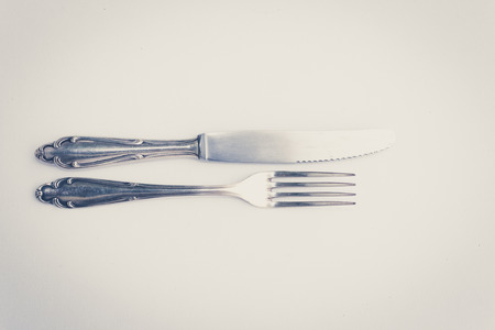 silver cutlery: beautiful old silver cutlery , knife and fork vintage style Stock Photo