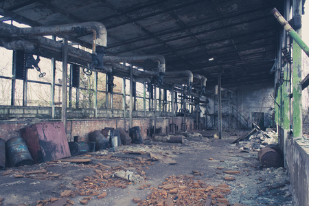 empty warehouse: old abandoned warehouse, empty messy factory Stock Photo