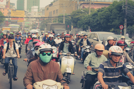 multiples: Saigon, Vietnam, January 17. 2014: Road traffic crowded with motorbikes and scooter drivers. Motorbikes are the most favorite vehicles in saigon.