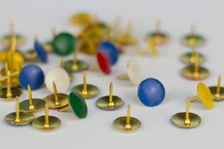 unpleasant: many thumbtacks isolated on white background
