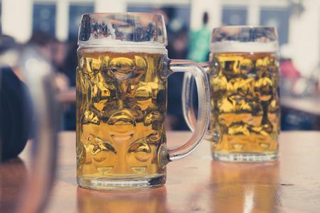 two beer glasses in German beer garden