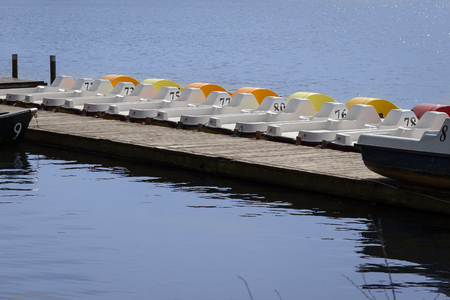 pedal: line of pedal boats on a pier - row of boats