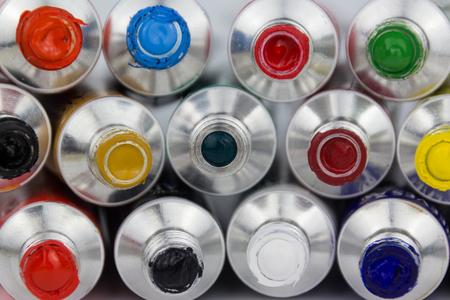 vibrance: many color paint tubes macro on white background Stock Photo