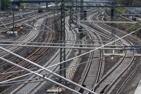 rail travel: railroad, rail tracks, railways and power supply lines - travel concept