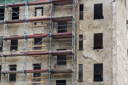 old building facade: construction site - old building facade with scaffolding