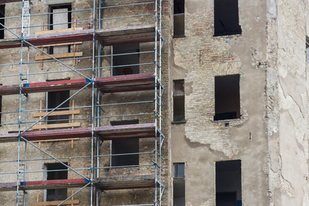 old building: construction site - old building facade with scaffolding