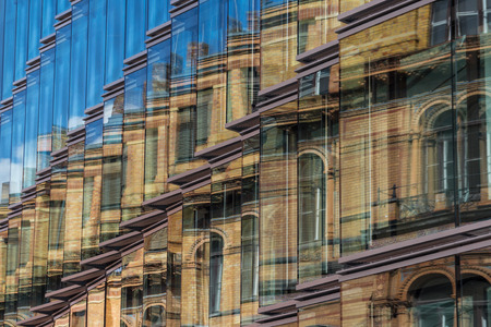old building: modern building and old building reflection on glass facade