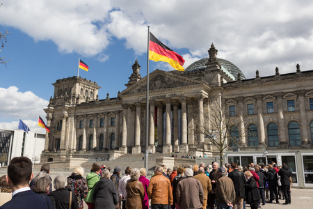 parliament building: Berlin, Germany - april 18, 2016: Queue of people waiting to get in the Reichstag building (The german parliament building) in berlin, germany.