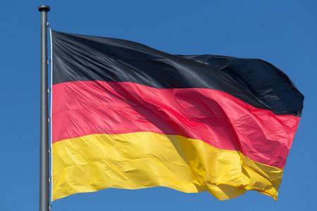 german flag: german flag, national flag of germany on blue sky