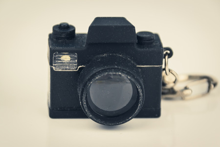 cam gear: miniature photo camera toy - photography concept, vintage filter
