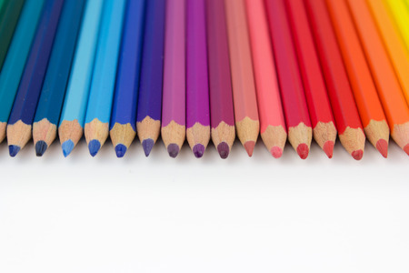 color crayons on white background - row of pencils Фото со стока