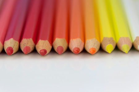 group of color pencils in a row