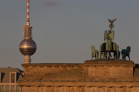 brandenburg gate: top of brandenburg gate and television tower - vintage filter