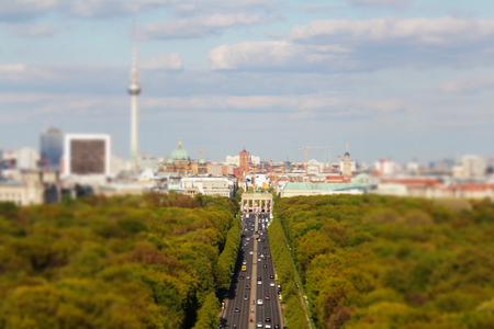 brandenburg gate: Berlin city skyline over brandenburg gate - tilt shift Stock Photo