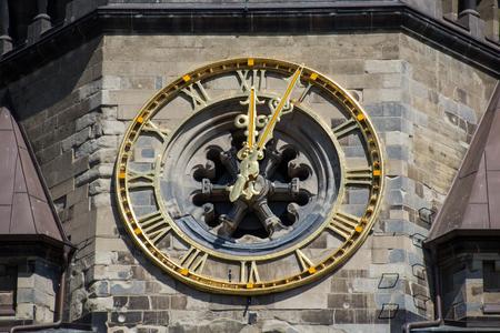 12 o clock: beautiful old golden clock on church tower closeup