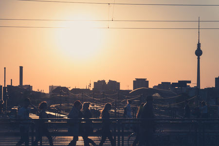 tv tower: people, berlin skyline and tv tower at sunset Editorial