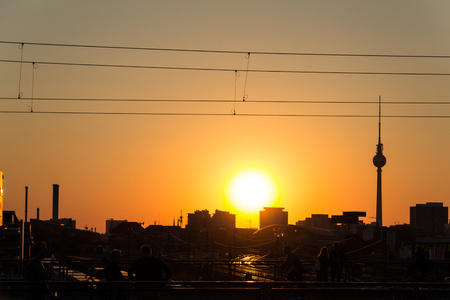 tv tower: people, berlin skyline and tv tower at sunset Stock Photo