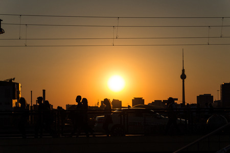 tv tower: peoples silhouette at sunset in berlin - tv tower Editorial