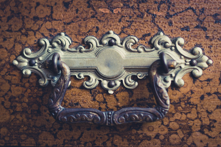 vintage furniture: old ornate furniture handle - vintage filter Stock Photo