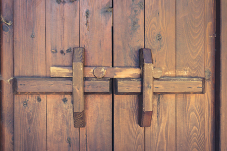 locking: closed wooden door with locking bar - vintage