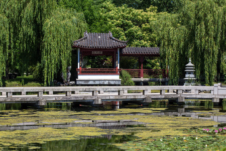 chinese garden: chinese garden, house at lake with water lilies Stock Photo
