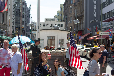 cold war: Berlin, Germany - June 29, 2016: Former border checkpoint Point Charlie in Berlin. A former border between East and West Berlin during the Cold War. Editorial