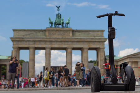segway and tourists at brandenburg gate, Berlin