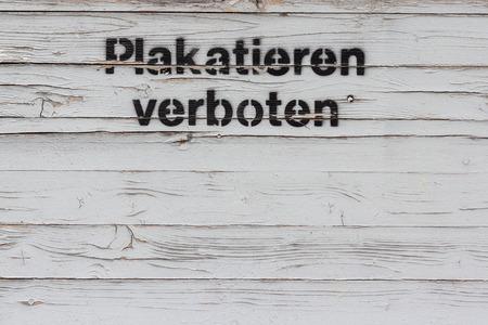 prohibido: placard forbidden - German: (plakatieren prohibited)