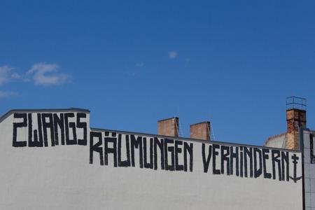 gentrification: Berlin, Germany - June 14, 2016: Stop evictions (german: Zwangsraeumung verhindern) graffiti on building facade in Berlin, Germany.