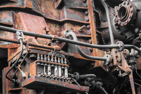 old time: old machine. rusty metal machinery detail. aged technology Stock Photo